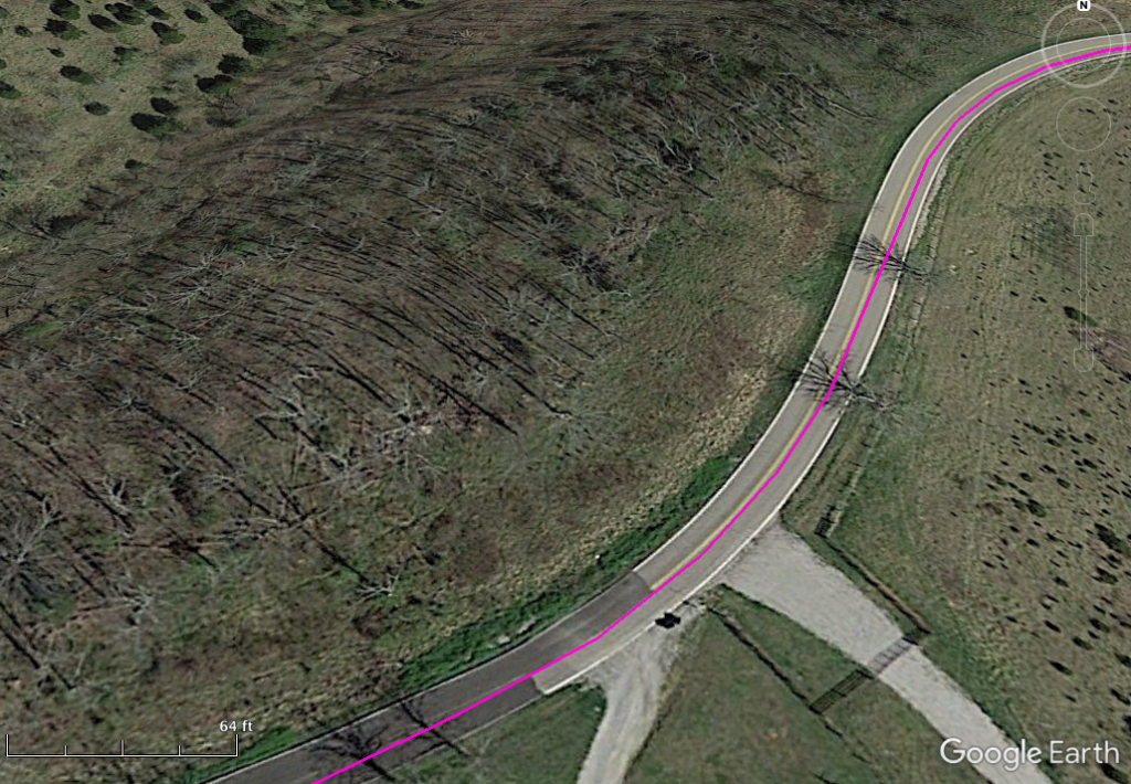 When zoomed way in, the satellite imagery in Google Earth is usually sufficient for confirming the road-surface.